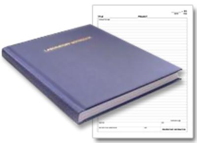 blue lab notebook with scientific ruled pages